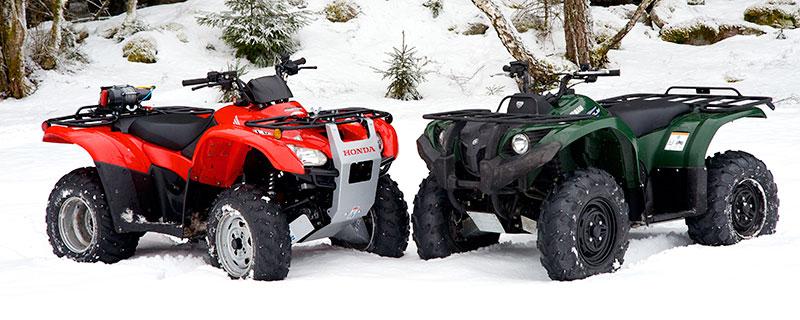 Honda TRX 420FPM och Yamaha Grizzly 450 EPS.